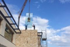 Montaggio con gru  vetrate isolanti - Provincia di Bologna